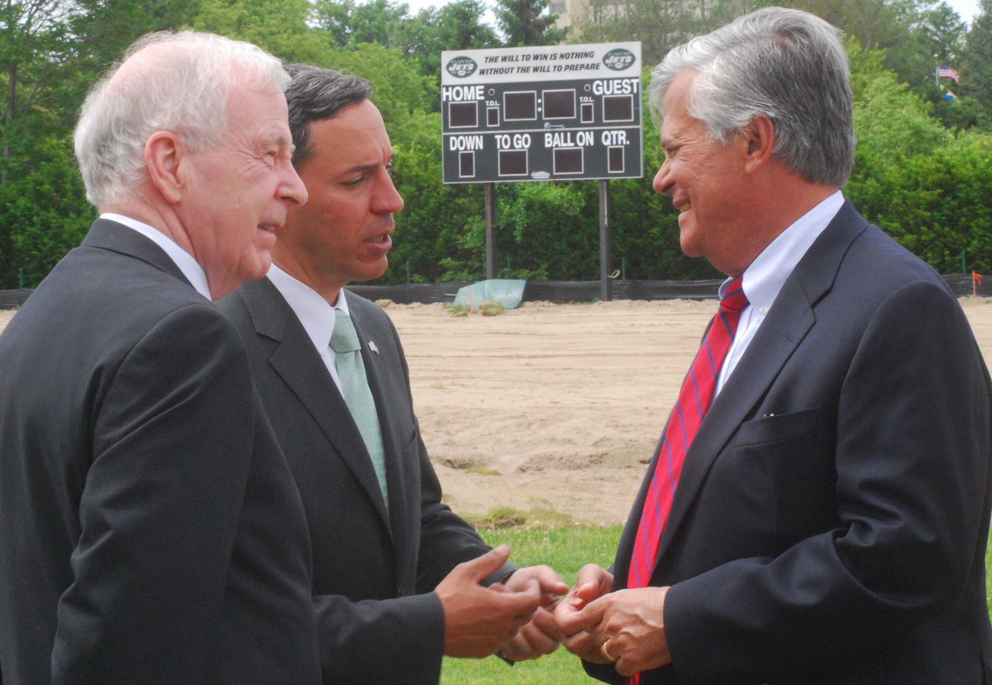 The addition to the medical school will be built at the Jets' former training camp on Hofstra's north campus. The Jets' scoreboard is still up, but will soon be taken down. Above, state senators, from left, Hannon, Jack Martins and Skelos chatting after the groundbreaking ceremony.