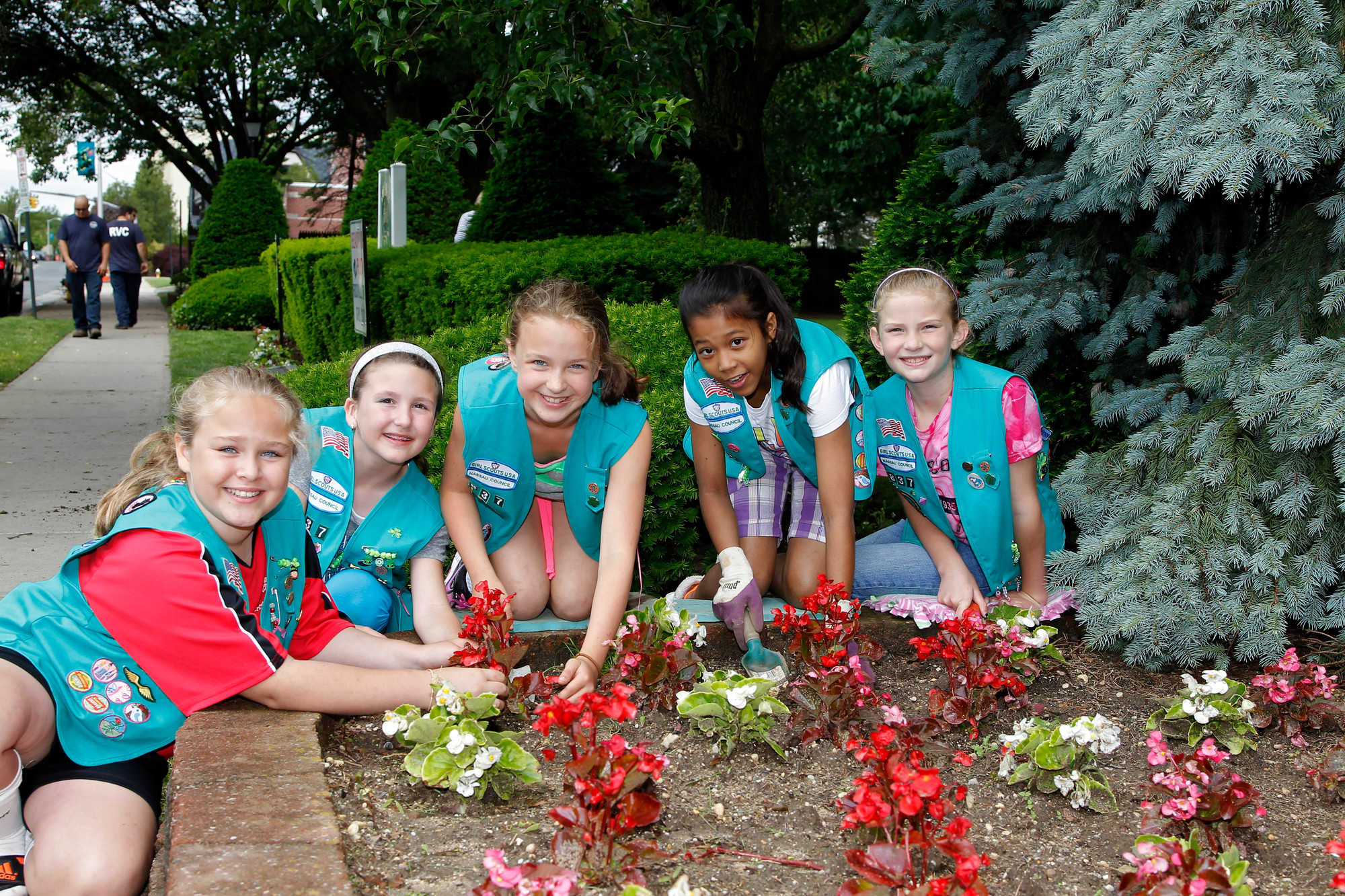 From left are 9-year-old Catrina Casella from Troop 837;  9-year-old Jamison Novello from Troop 837;  10-year-old Maggie Kutner from Troop 837; 10-year-old Kayla Chin from Troop 840 and 9-year-old Reilly Minnigan from Troop 837 with some of the plantings that were done during the beautification project Saturday.