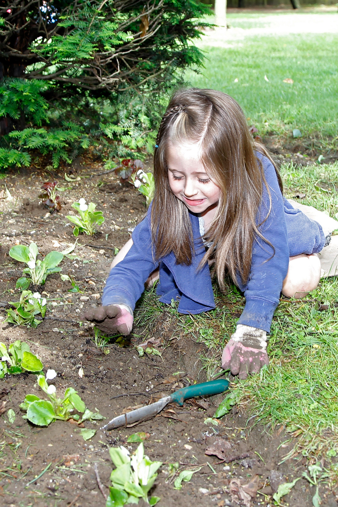 Six-year old Margauz Rivara, a Daisy from Troop 808, was hard at work planting.