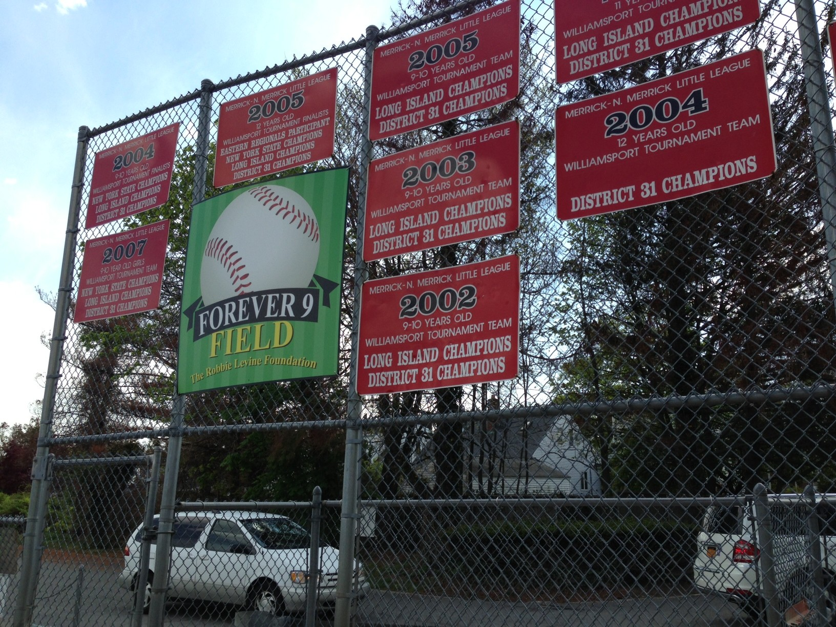 A Forever 9 Field sign amid the Merrick Little League�s championship banners.