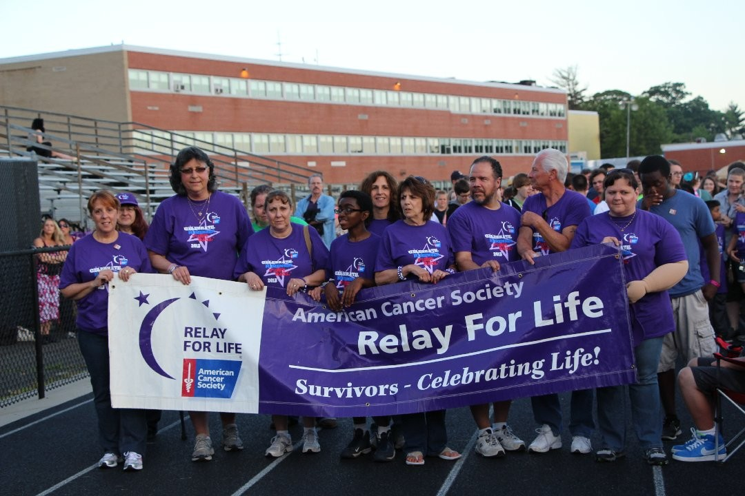 The banner denoting the opening lap of the Relay for Life was held by numerous people including Donna Lerner, Carol McAuley, Karon Jones, Margaret Bernstein, Miguel Melendez and Paula Kulla.