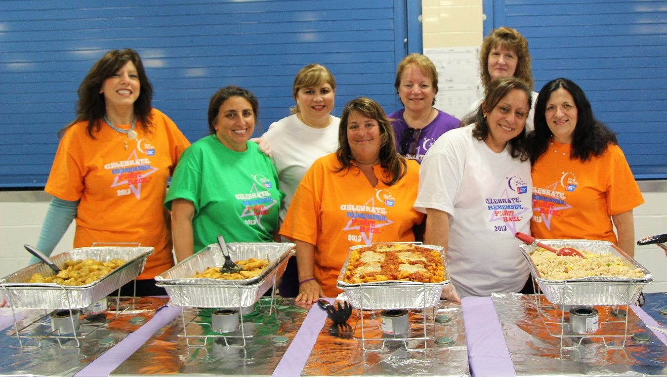 Relay for Life committee members served a survivor's dinner to kick off the night's events. Pictured are Josephine Capizzi, Renee Salmon, Nora Shaahan, Jennifer Scars, MaryAnn Romano, Jacoba Evans, Kathleen Taravella and Maryann Quinn.