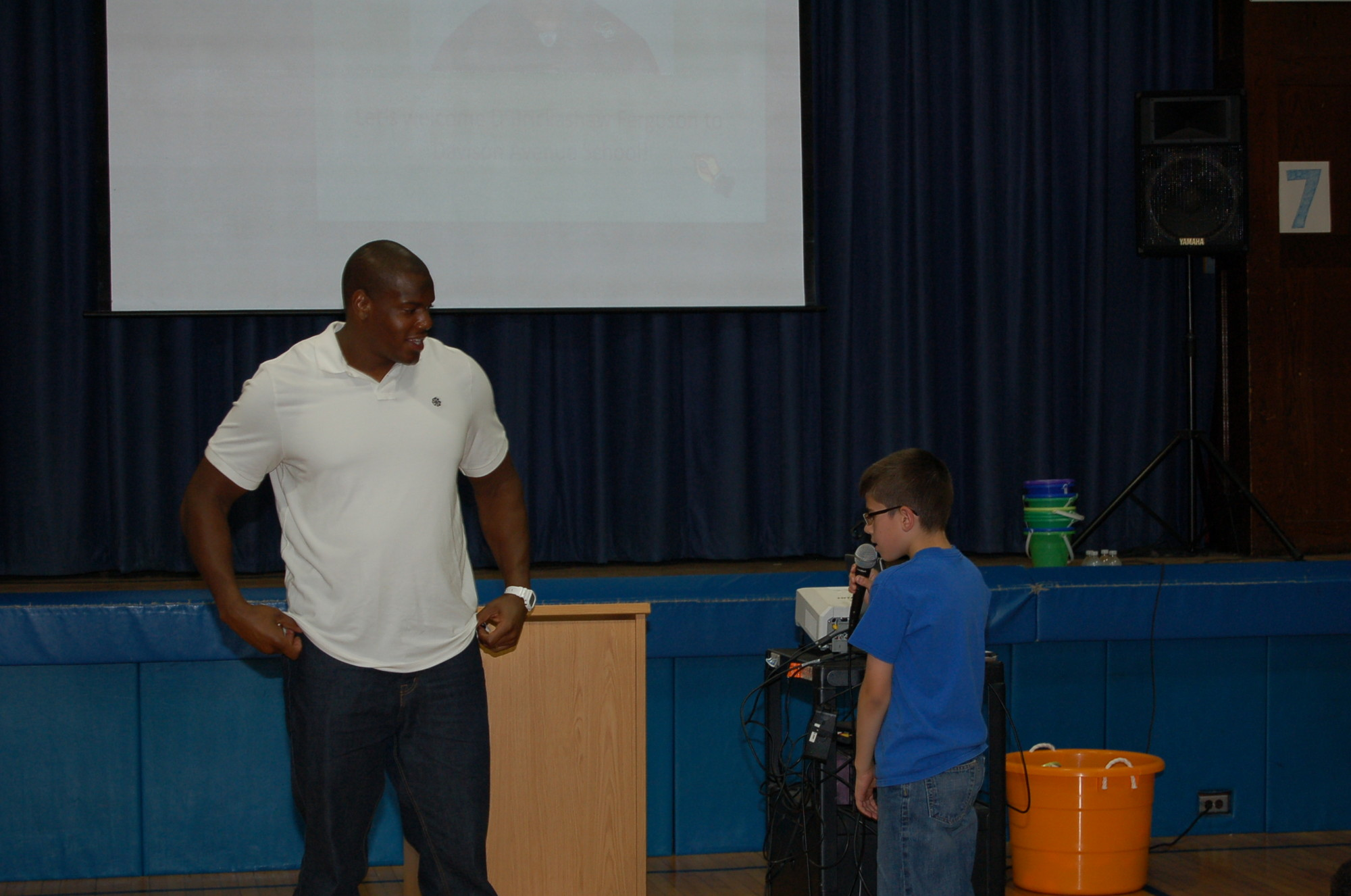 A Malverne middle school students asks the football player a question.