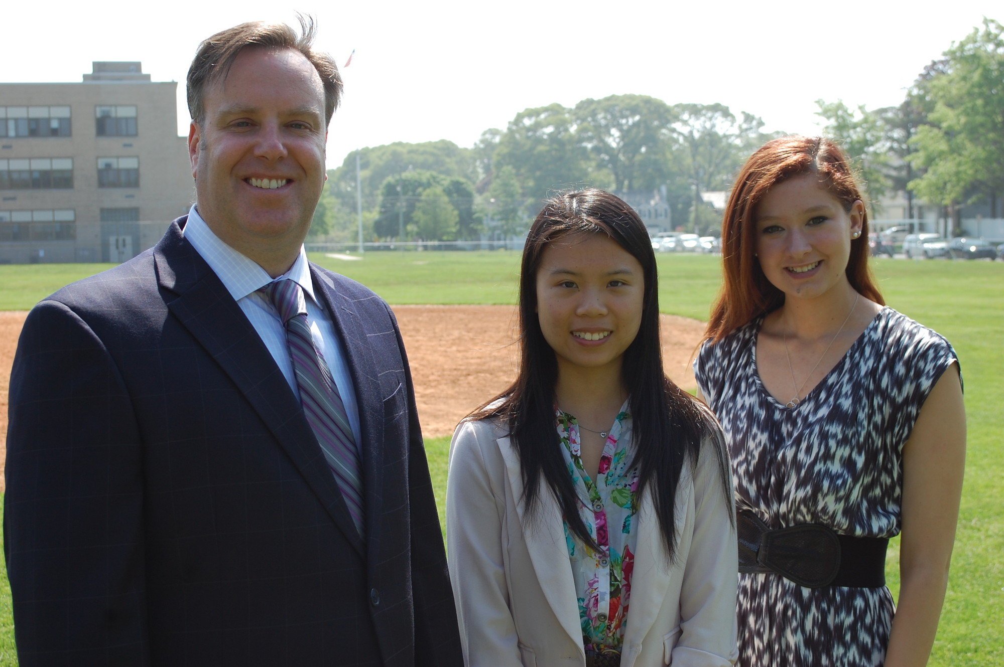 Michelle Chen, center, and Angelica Caluori are the valedictorian and salutatorian, respectively, of North High School�s class of 2013. They are joined by Superintendent Dr. Bill Heidenreich.