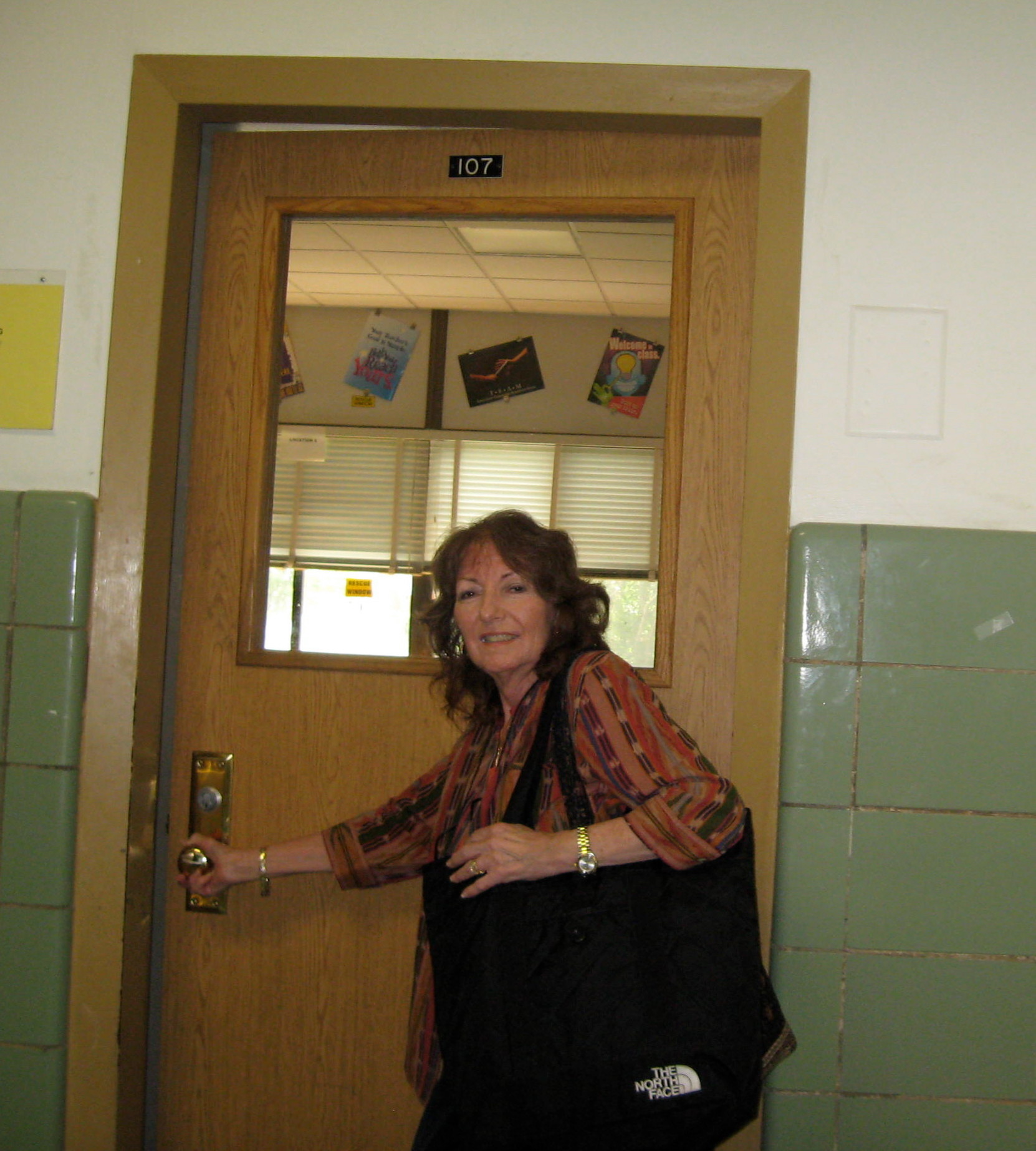 Stephanie Ginsberg at her classroom door at Memorial Junior High.