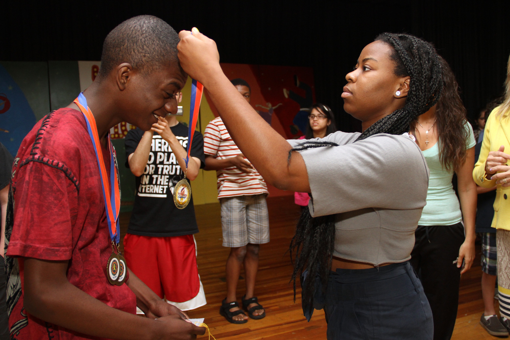 Joardany Jean-Pierre received a gold medal from Janice Louis at an awards presentation in South Hall on June 4.