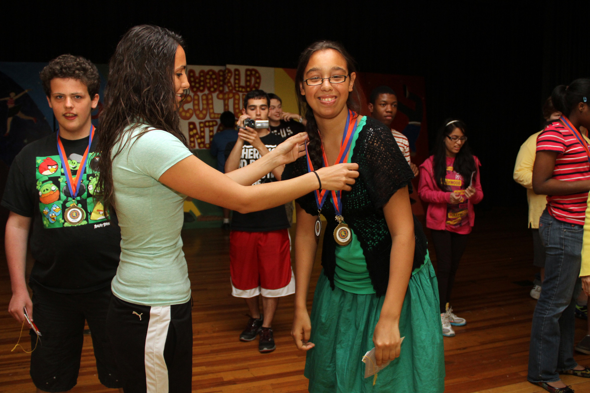 Mandi Espino received a gold medal from teacher Jessica Ricotta.