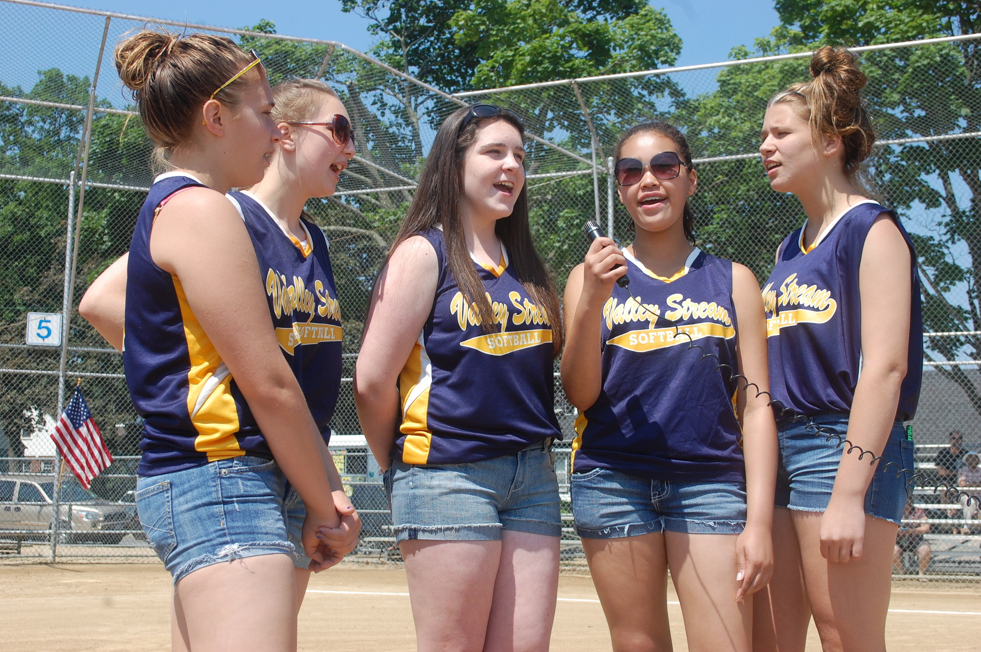 Softball players opened the ceremony by singing the National Anthem.
