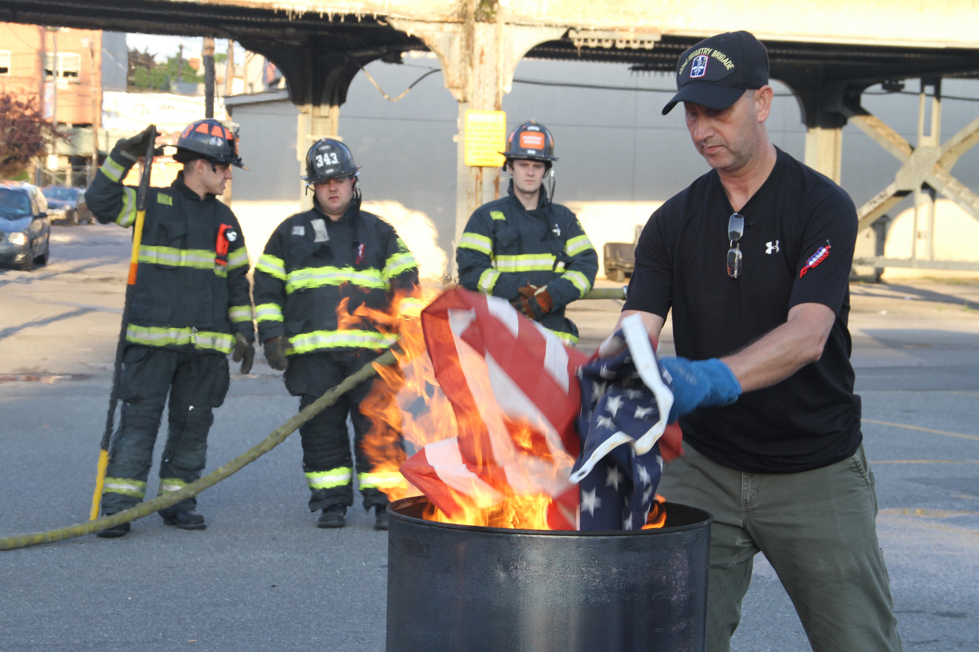 Eddie Nachreiner, the sergeant at arms for American Legion Post 854, burned worn American flags last Friday evening to mark Flag Day. Members of the Valley Stream Fire Department�s Engine Company No. 3 stood by.