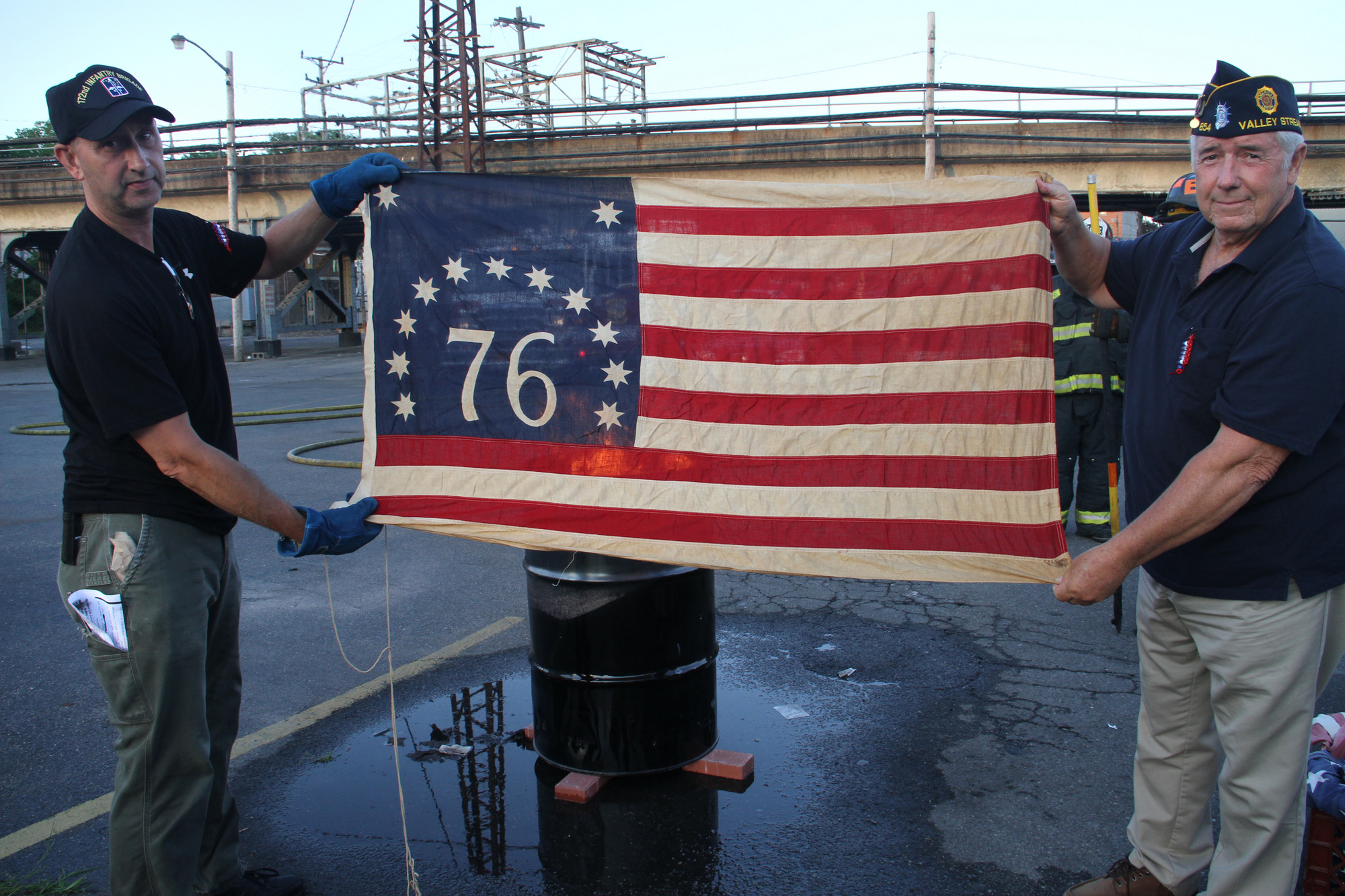 American Legion Post 854 members Eddie Nachreiner and Bob Gendron showed an old bi-centennial flag that was disposed of last Friday evening.