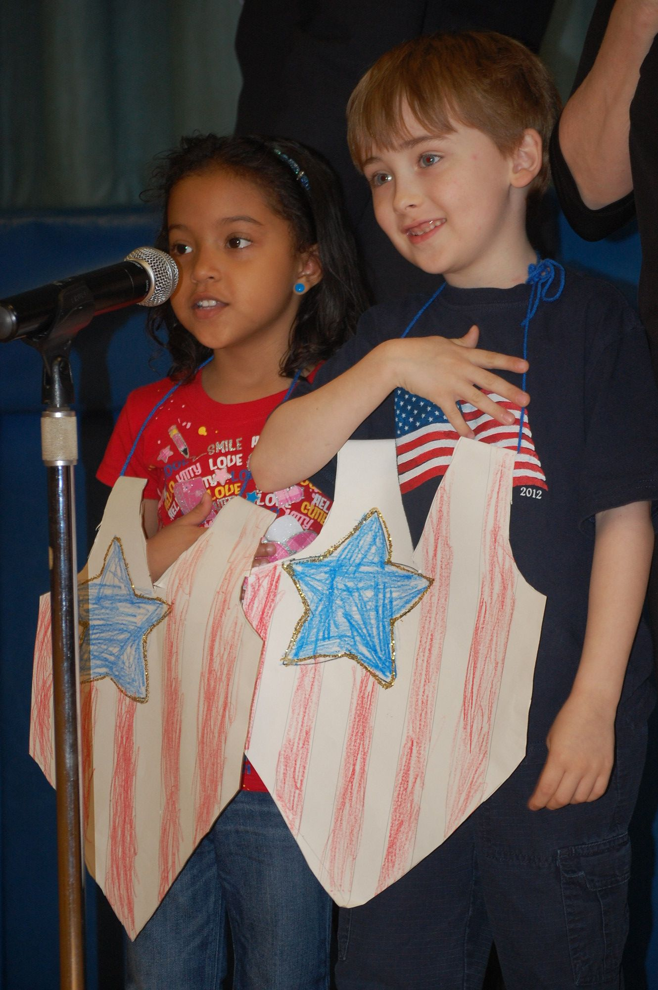 Patrick Biondolillo and Aliyah Frontin led the salute to the flag at the Carbonaro School on June 14.