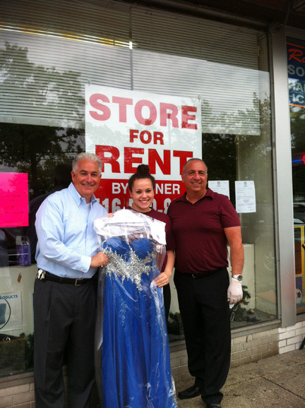 Karyl Taylor, a senior at Clarke High School, was reuinted with her prom dress with the help of court-appointed receiver Chris Coschignano, left, and Jim Dandy Cleaners owner Florestano Girardi.