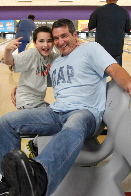 Stevie Farinella, 8, and his dad, Anthony, were one of many father-and-son duos who participated in the 3rd annual Barnum Woods PTA bowling night out at East Meadow Bowl in honor of Father's Day on June 14.
