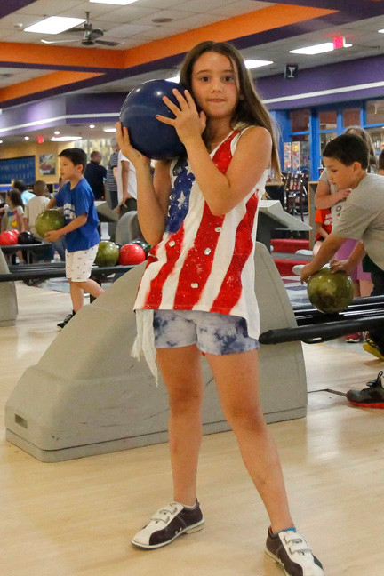 Morgan Derwin, 9, practiced her bowling skills during the Father's Day bowling event.