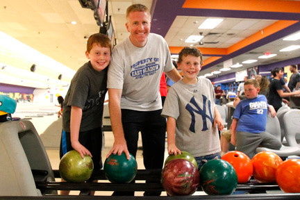 Event organizer Todd Weinstein with his sons Alex, 10, on left, and Evan, 7,  shared some quality bonding time during the Barnum Woods PTA bowling event. More than 160 local residents participated in the night's festivities at East Meadow Bowl on Front Street.
