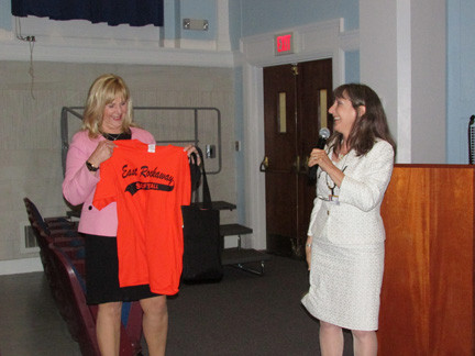 Retiring Superintendent Roseanne Melucci presented Ruiz with a girls' champions softball T-shirt and an East Rockaway visor, courtesy Coach Joe Lores.