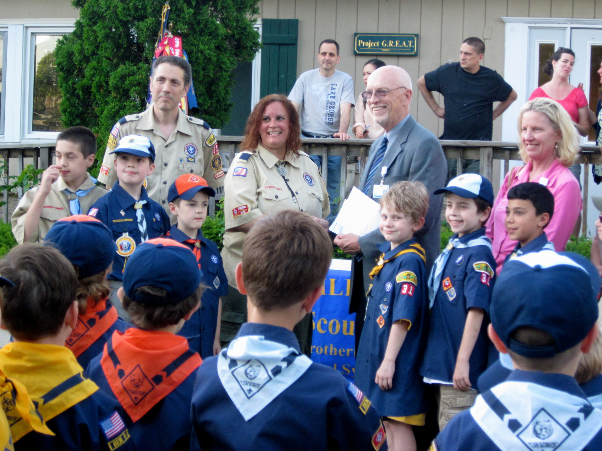 Scouts in Pack 31 handed over a $403 check to Project HOPE for Sandy relief.
