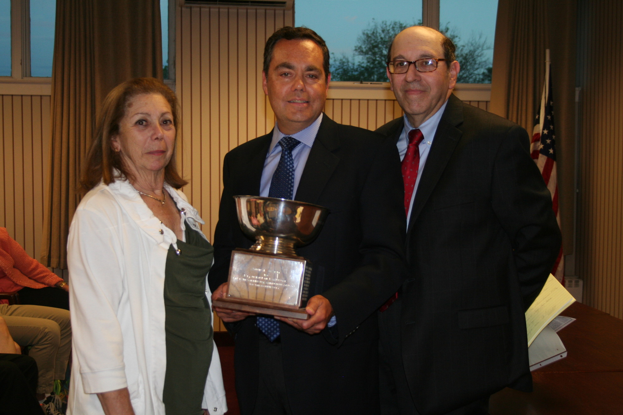 The Lawrence Association bestowed its Crowell Baker Award for distinguished public service to Edward Gottlieb, center. From left were past recipient Jacqueline Handel and Ron Goldman, the group's president.
