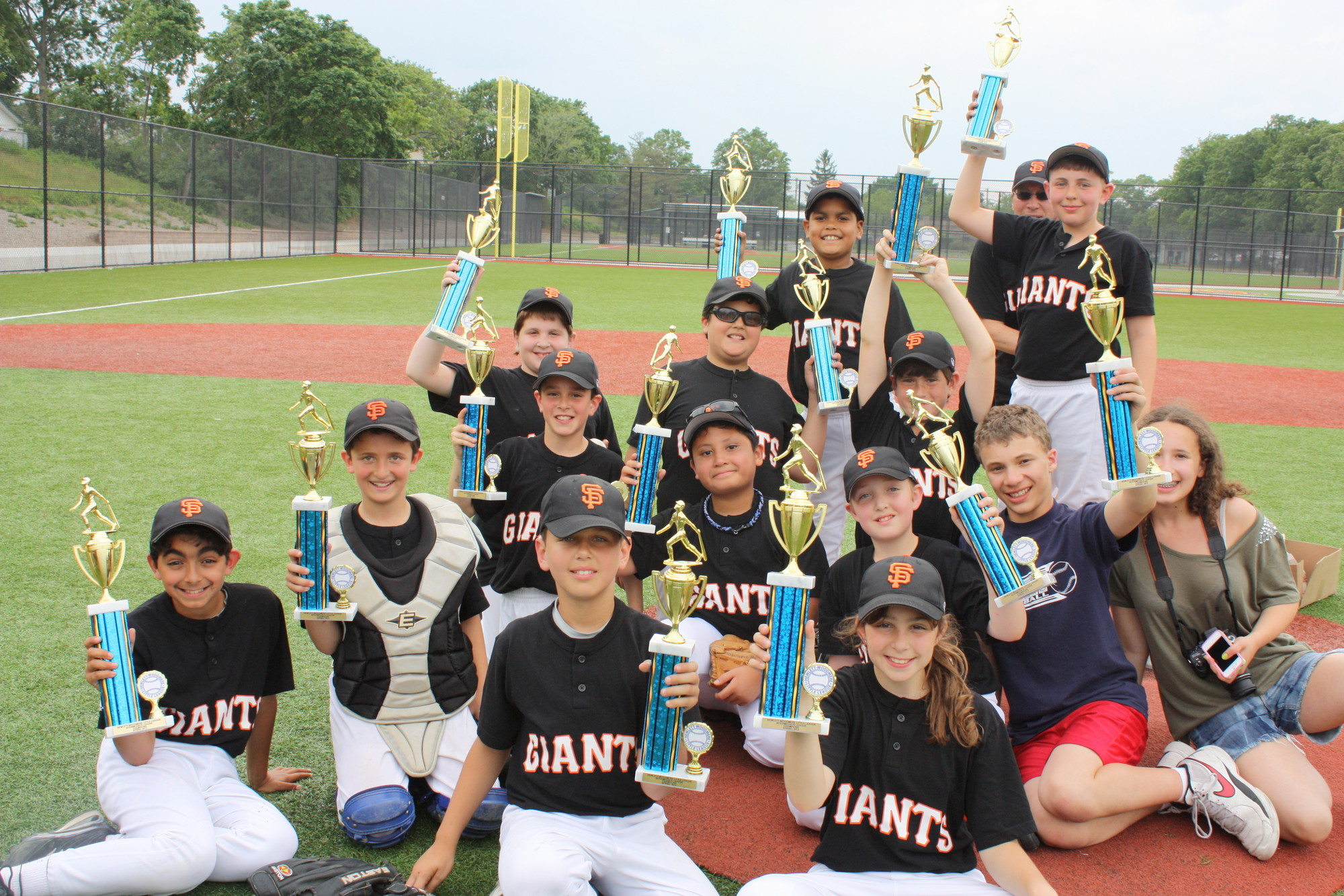 Trophies were raised after the Giants won the Intermediate Division crown.