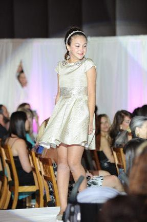 Models of all ages showed off the latest designs as they strutted their stuff on the catwalk.