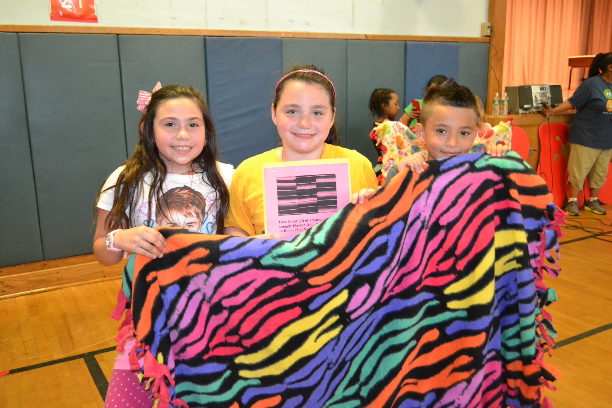 The Number Two School commemorated Peace Day as part of its Social Emotional Learning program. From left Guinevere Hernandez, Samantha Puzio and Johanny Moreno displayed one of the donated blankets.