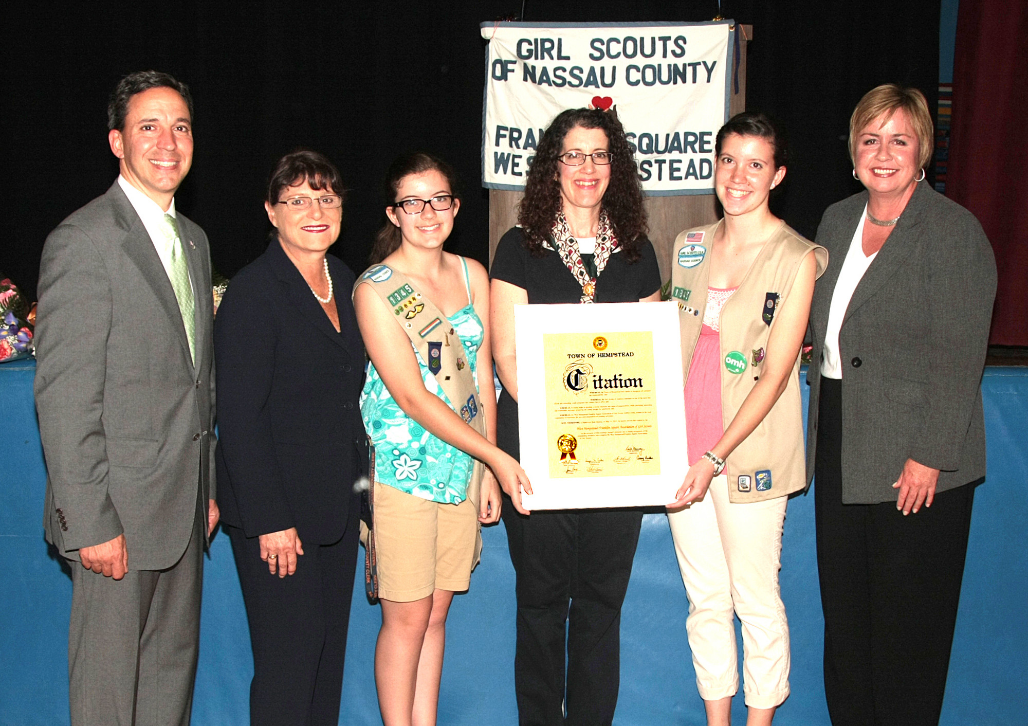 New York State Senator Jack Martins, left, Nassau County Clerk Maureen O'Connell and Town Supervisor Kate Murray, right, honored Troop 1345 Leader Carol Anne Stiklickas, Emily Stiklickas and Gold Awardee Sara Stiklickas.
