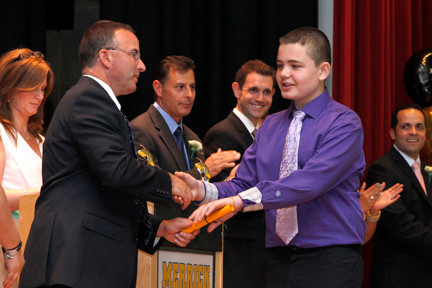 Brian Zharov received a diploma from the school principal, Dr. Meador Pratt.
