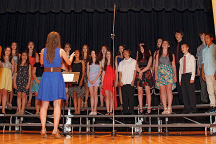 "Dana Brandwein directed the MAMS a cappella group ""Word of Mouth"" in a performance of ""God Bless America."""