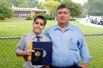 Anargiros Tsempelis displayed his perfect attendance award with his proud dad, Charlie.
