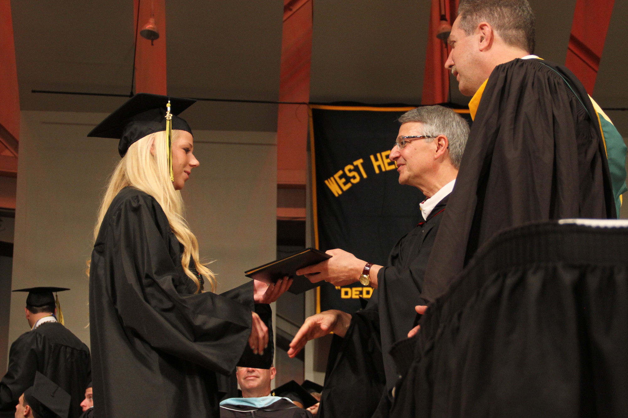 Kelly Feeley greeted Superintendent John Hogan as she received her diploma.