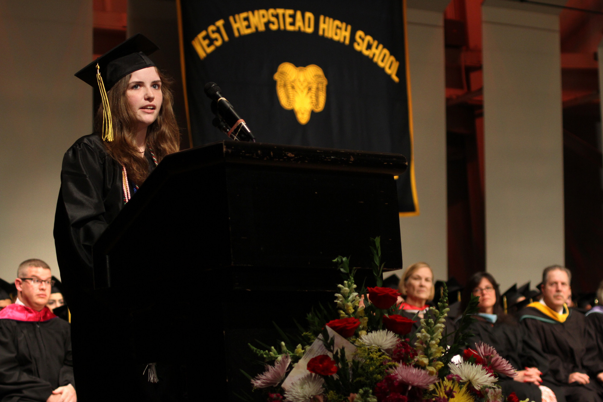 Valedictorian Caroline Moyer Laurin noted how the lessons she learned in high school helped her to grow and excel as a person who can make a difference.