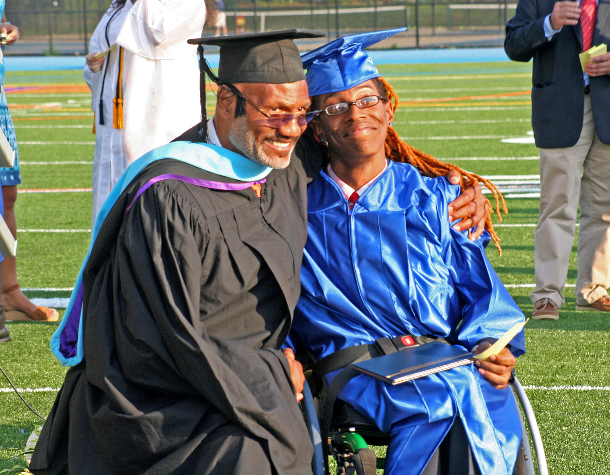 Retiring Principal James Brown with graduate Shane Knox.