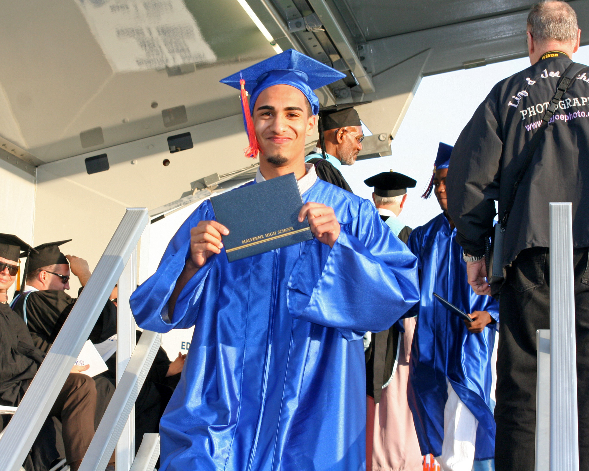 Malverne High School graduate Steven Reyes proudly showed off his diploma.