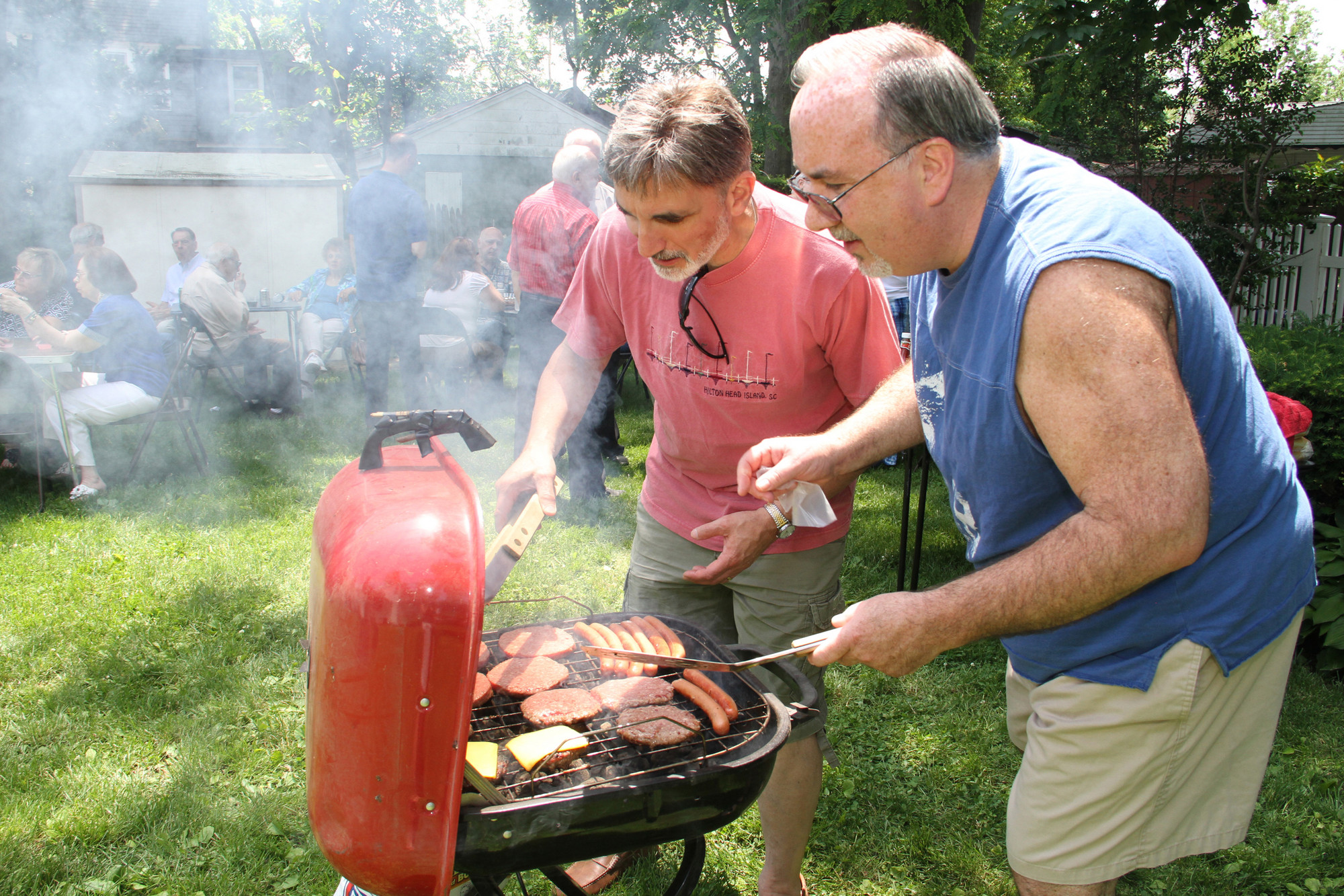 Rick Grieco and Ed Hassel man the grill.