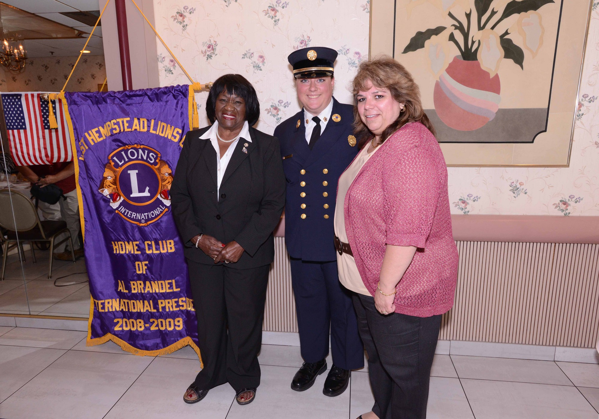 Councilwoman Dorothy L Goosby congratulated Chief Heather Senti, center, as the first woman to serve in her position in the West Hempstead Fire Department.