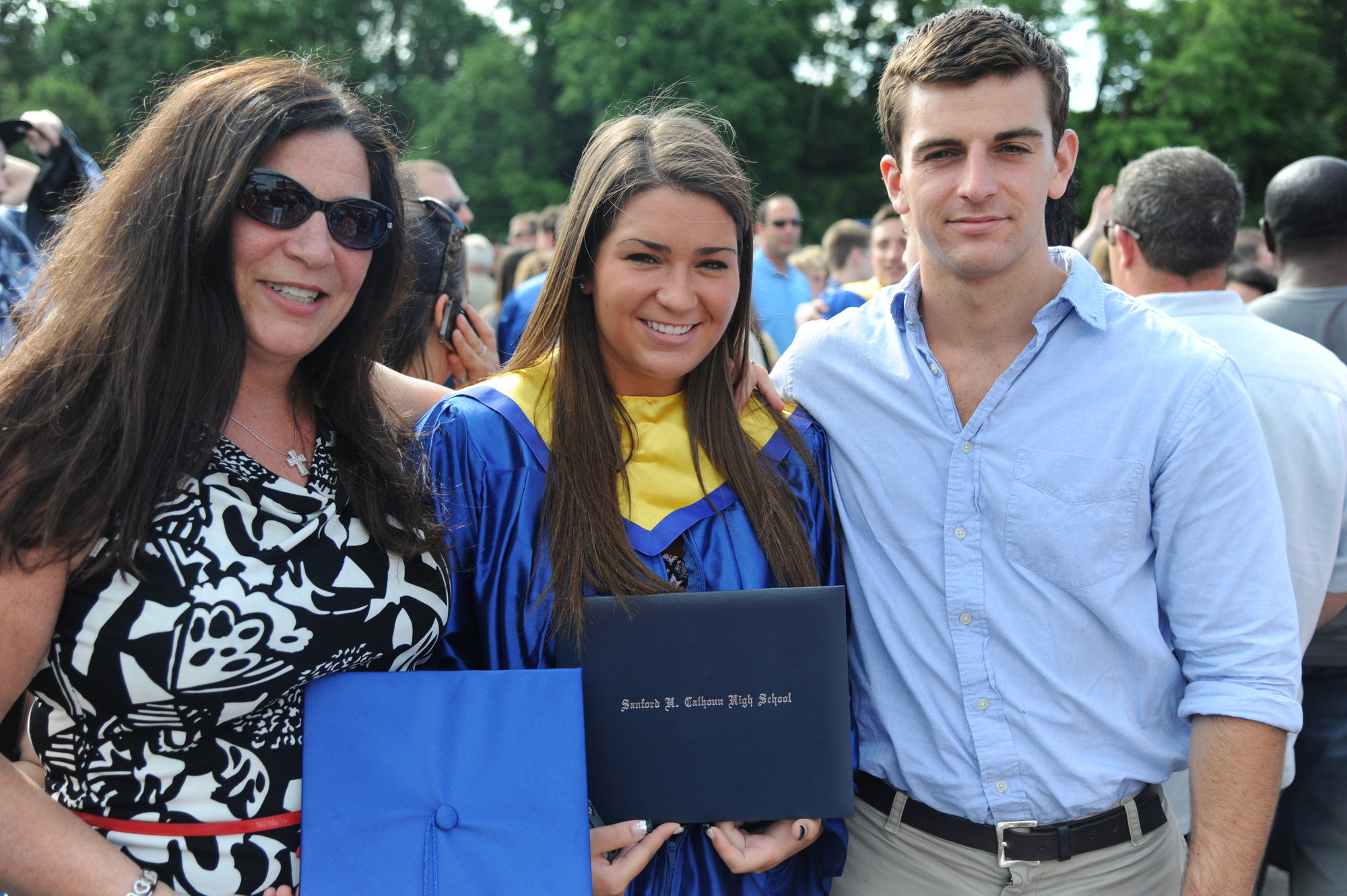 Melanie Krug (center) celebrated graduation with her mom, Pat, and her brother, Joe.