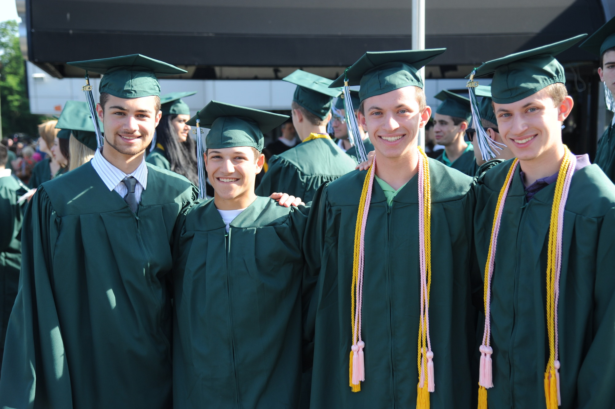 Michael Lopalo, Michael Librizzi, Blake Lingenau, and Dylan Lingenau flashed smiles at their graduation.