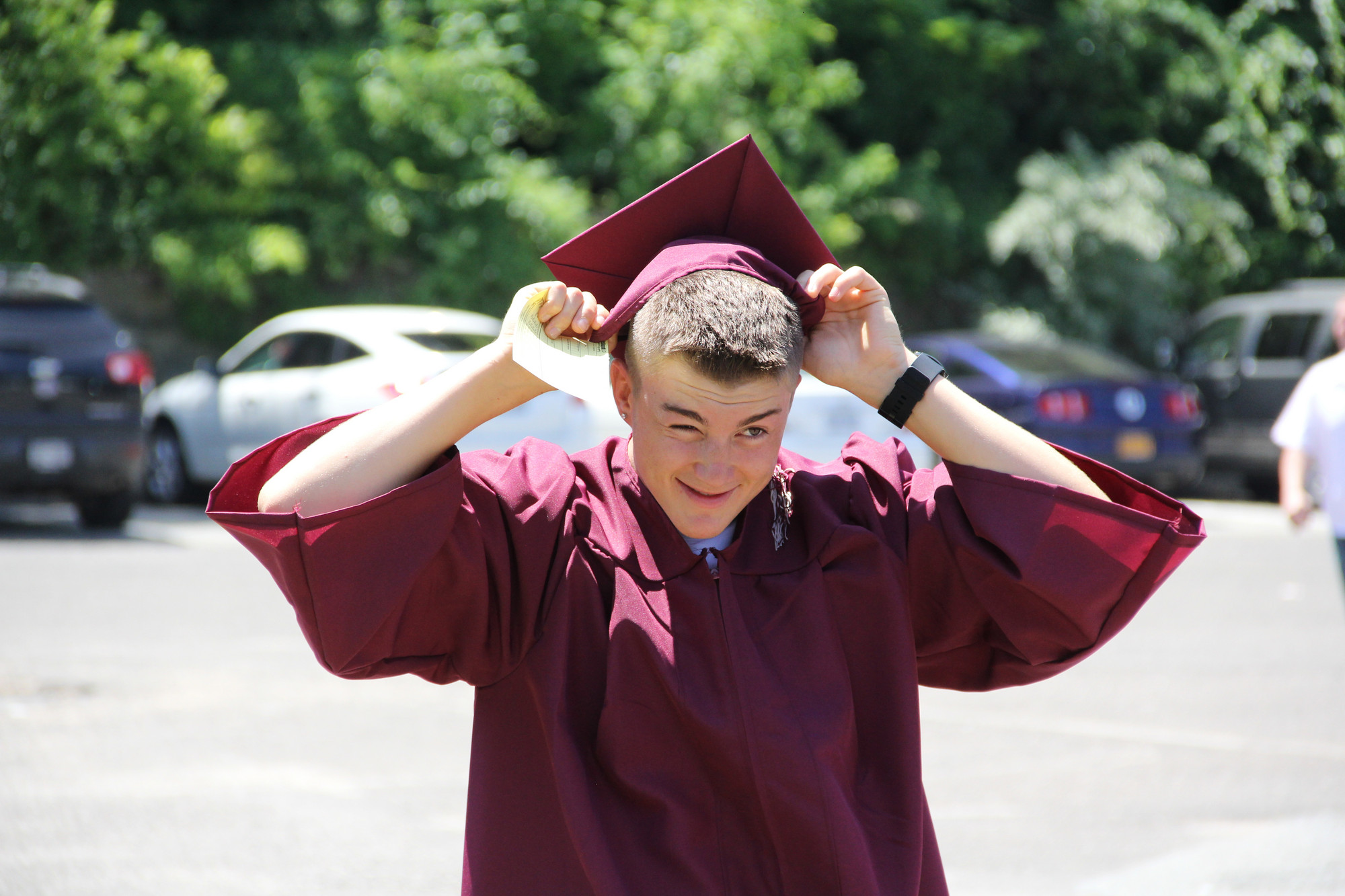Tyler Clougher tried to fix his mortarboard before heading into the NYCB Theater for Mepham's graduation.