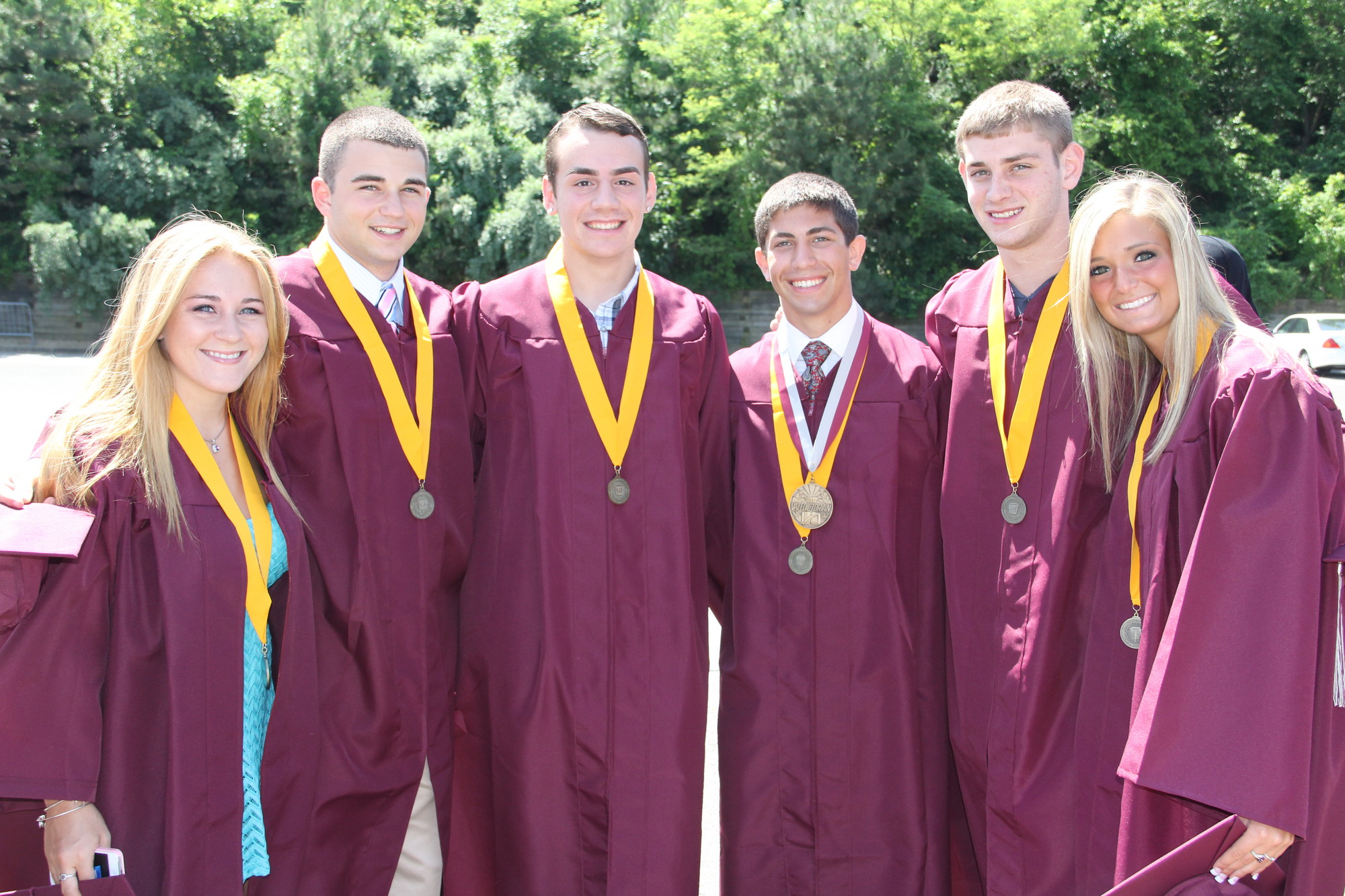 Sam Deluca, Eric Lugassy, Dennis Hassett, Mepham valedictorian Connor Garet, Brian McArdle and Samantha Maddalena wore medals designating their membership in National Honor Society.