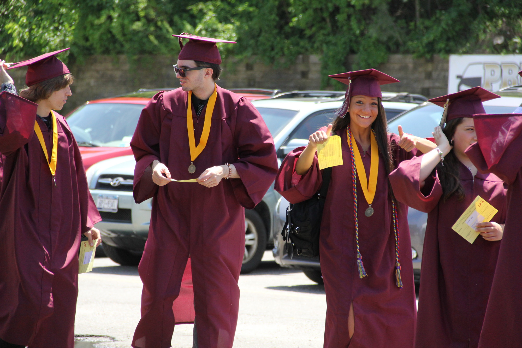 Elyssa Gershman, right, gave an enthusiastic thumbs-up during Mepham�s graduation procession.