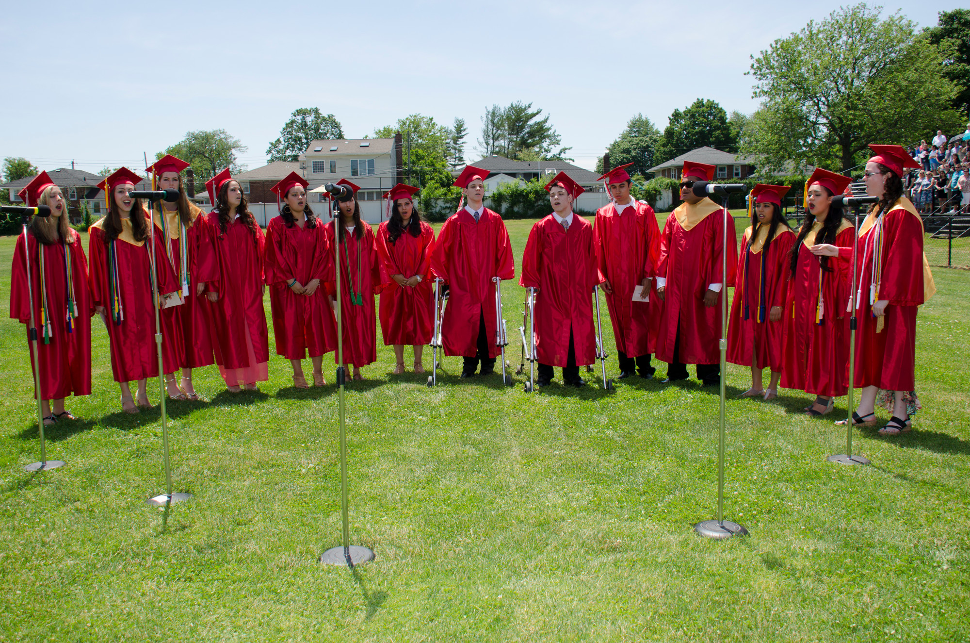 The senior chorus performed under sunny skies at the beginning of Sunday�s graduation ceremony on the W.T. Clarke High School football field.