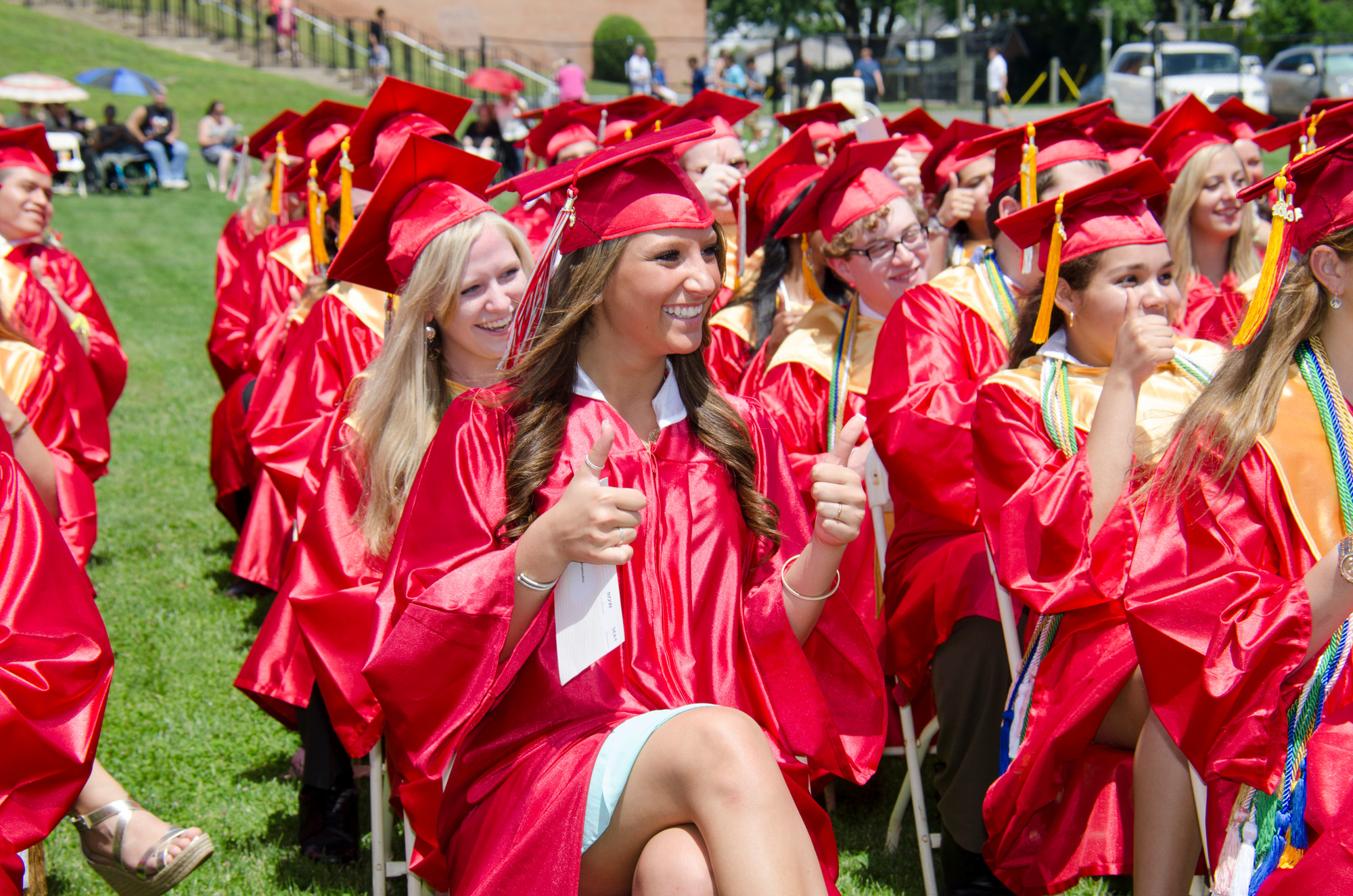 The graduating class gave a cheerful thumbs up at the request of class president Jason Dunleavy.