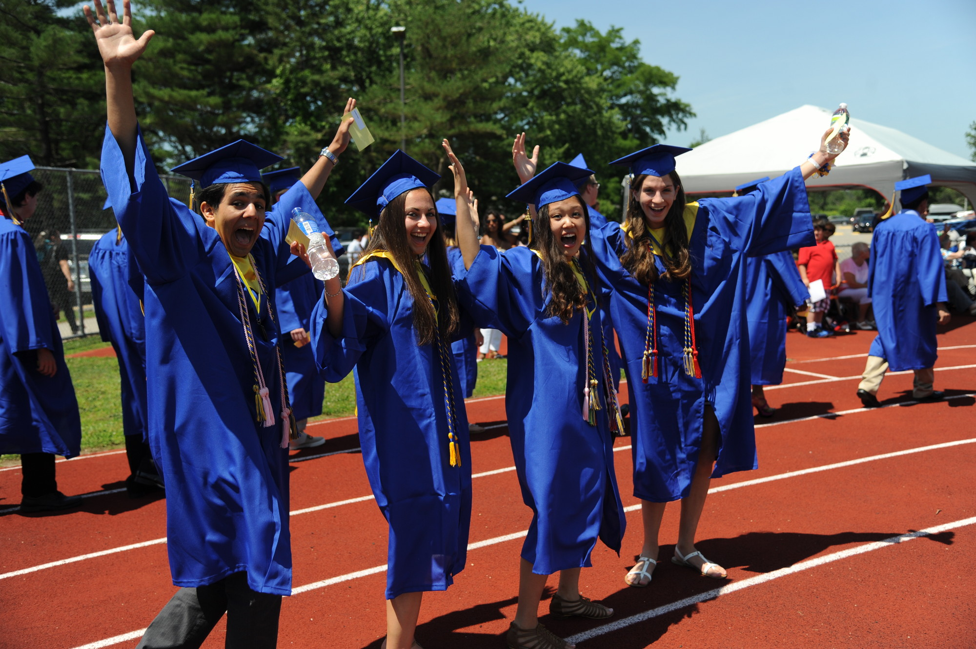As students entered the football field to begin the graduation ceremony on Sunday, these four excited seniors expressed their excitement to be among the East Meadow High School graduating class of 2013.