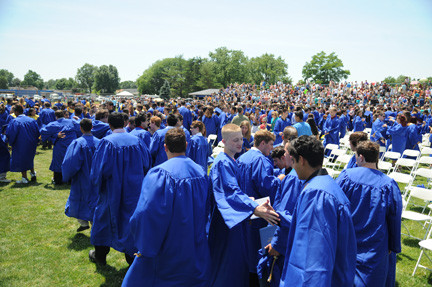 The John Barbour Memorial Field was packed as graduates, school officials and family members arrived for the ceremony.