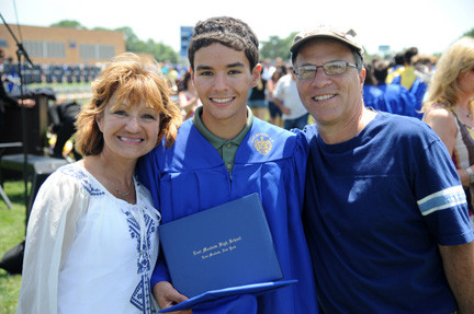 East Meadow graduate Aaron Roberts with mother Gina and father Neil.