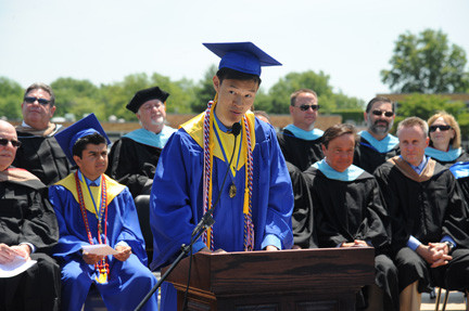 East Meadow High School salutatorian and class president Anson Wang addressed his peers during the graduation ceremony.  At left was valedictorian Neil Khosla, and at right, Superintendent Louis DeAngelo.