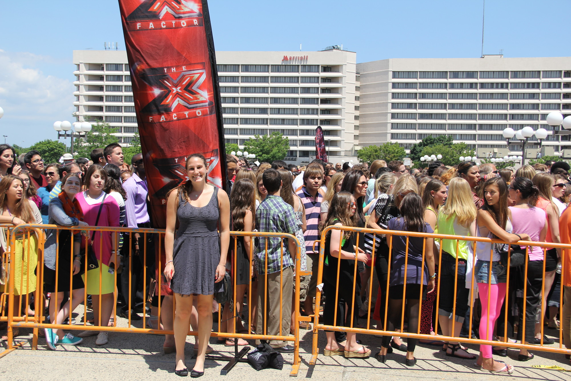 Long Island Herald intern Jess Rosen, 21, spent the day at the Nassau Coliseum in Uniondale to view a live recording of The X Factor. Behind her, thousands of fans of the Fox show filled the arena.