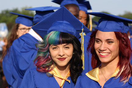 Melanie Martinez, a local talent who appeared on the Voice earlier this year, waited for her diploma with friend Kayla Martinez.