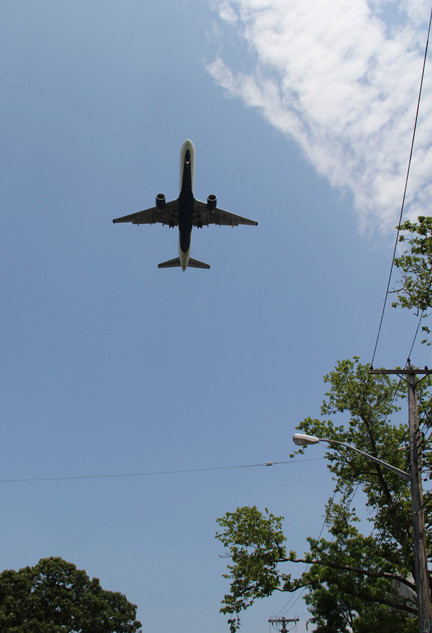 A plane flies over Southwest Nassau as it approaches JFK.