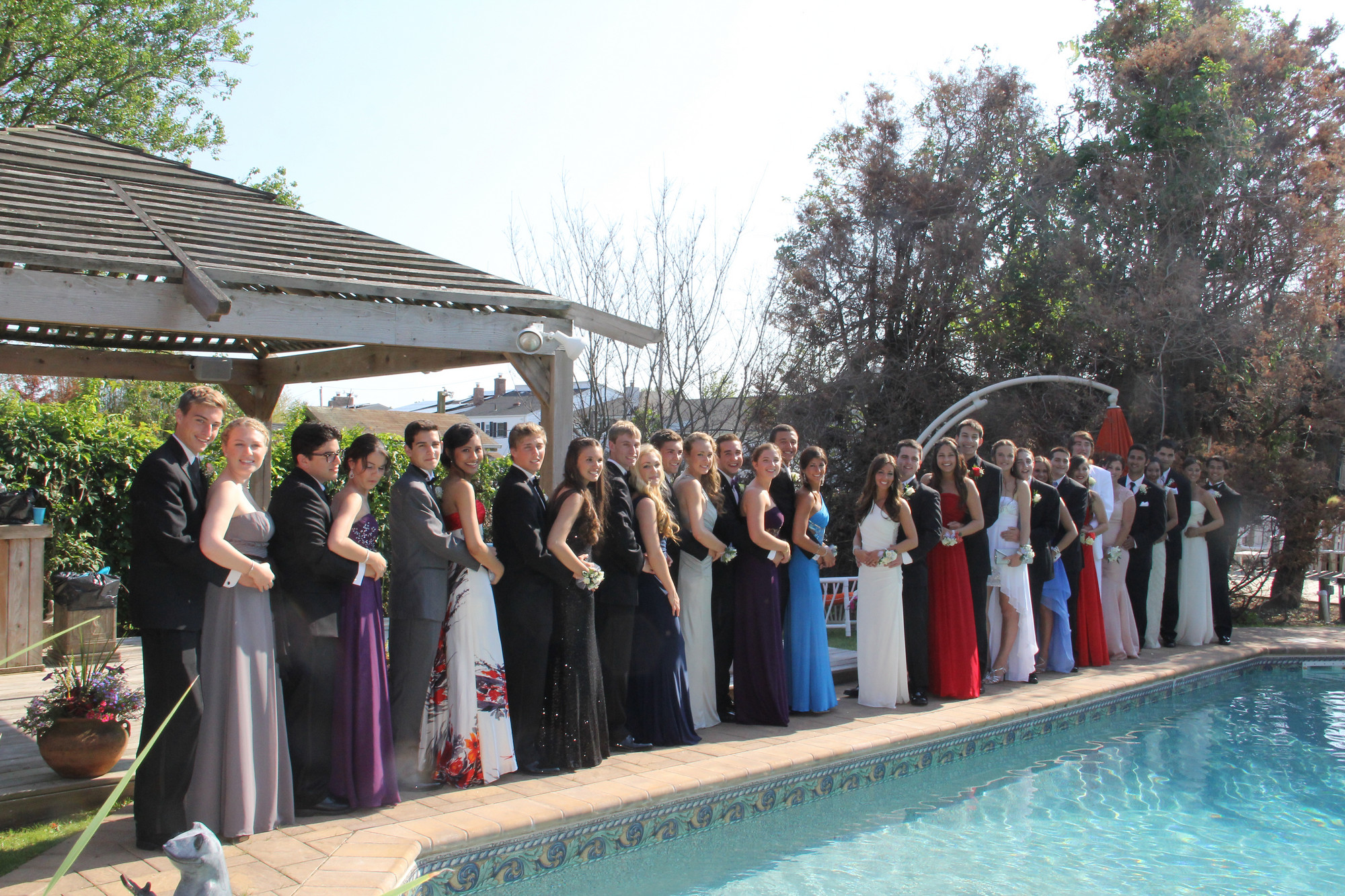 The group lined up by the pool so parents and friends could take photos. About 120 people attended a pre-prom party hosted by LBHS parent Bonnie Goetz.